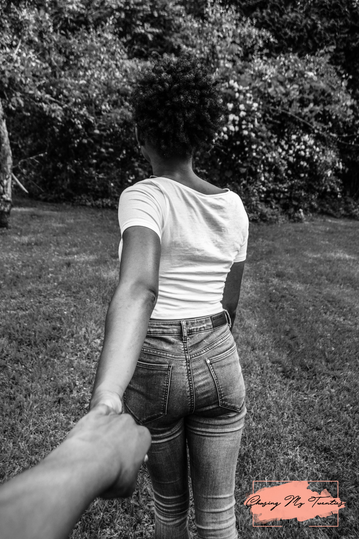 Girl holding guys hand